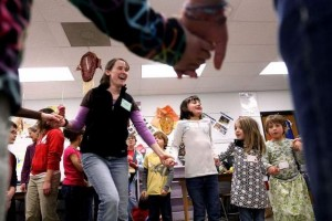 Grace Gordon, left, dances with children Saturday during the Kids Conference, part of the 33rd annual Ohio Ecological Food and Farm Association Conference at Granville Middle School. / Zach Gray/The Advocate